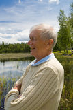 Happy senior by a lakeside Stock Photo