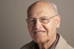 Happy senior man. Portrait of a senior man over grey background Royalty Free Stock Image