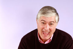 Happy senior man. Smiling older man on purple background royalty free stock photos