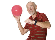 Happy senior man with ball. Senior man about to throw a large ball royalty free stock image