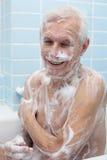 Happy senior man bathing Royalty Free Stock Photography