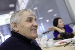 Happy senior man in cafe Stock Photos