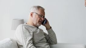 Happy senior man calling on smartphone at home 100 stock video footage