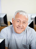 Happy Senior Man In Computer Class Royalty Free Stock Image