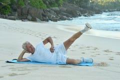 Happy Senior man exercising in summer Stock Photos