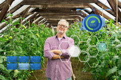 Happy senior man at farm greenhouse Royalty Free Stock Photos