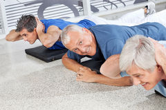 Happy senior man in fitness center Royalty Free Stock Image