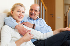 Happy senior man flirting with mature wife and hug Stock Photography