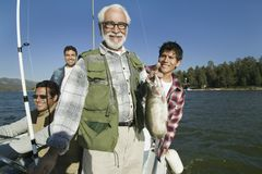 Happy Senior Man With A Fresh Catch Royalty Free Stock Photos