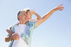 Happy senior man giving his partner a piggy back Stock Image