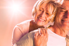 Happy senior man giving his partner a piggy back Royalty Free Stock Image