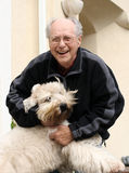 Happy senior man and his dog Royalty Free Stock Image