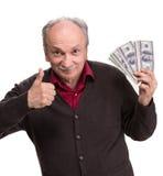 Happy senior man holding dollar bills Stock Photos