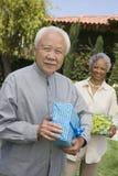 Happy Senior Man Holding Gift Royalty Free Stock Photo