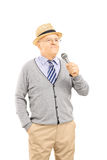 Happy senior man holding a microphone Royalty Free Stock Photo