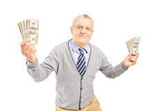 Happy senior man holding money bankontes Royalty Free Stock Image