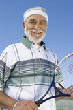 Happy Senior Man Holding Tennis Racket Royalty Free Stock Images