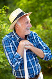 Happy senior man at home in garden Stock Photos