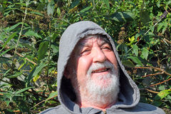 A happy Senior man in hood laughing. Close up Royalty Free Stock Photo