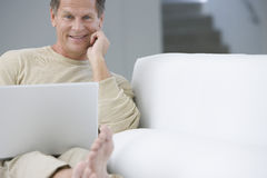 Happy Senior Man With Laptop Stock Photos