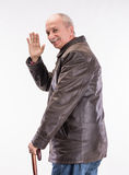 Happy senior man in leather jacket with umbrella Stock Photography