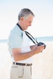 Happy senior man looking at his camera Stock Images