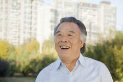Happy Senior man looking at the sky, portrait Royalty Free Stock Photo