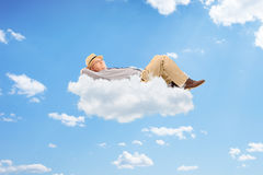 Happy senior man lying on cloud Royalty Free Stock Photo