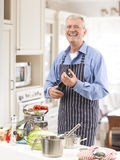 Senior Man in the Kitchen Royalty Free Stock Photos