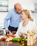 Happy senior man and mature woman doing chores Stock Images