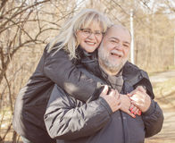 Happy Senior Man Mature Woman Piggyback Outdoor Royalty Free Stock Photo