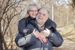 Happy Senior Man Mature Woman Piggyback Outdoor Royalty Free Stock Photography