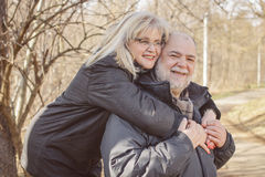 Happy Senior Man Mature Woman Piggyback Outdoor Stock Photography