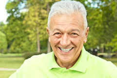 Happy senior man outdoors Stock Photo
