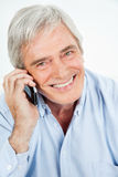 Happy senior man on the phone Stock Photo