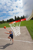 Happy senior man playing basketball royalty free stock photography