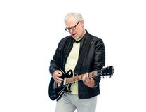 Happy senior man playing electric guitar Stock Photo