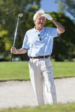 Happy Senior Man Playing Golf In Bunker Royalty Free Stock Photo