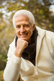 Happy senior man posing with hand on chin Royalty Free Stock Images