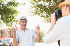 Happy senior man posing for his partner taking photo Royalty Free Stock Photography