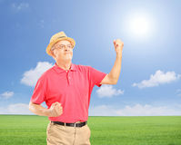 Happy senior man with raised hands gesturing happiness Royalty Free Stock Photography