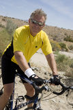 Happy Senior Man Riding Bicycle Stock Photo