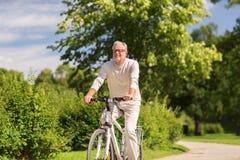 Free Happy Senior Man Riding Bicycle At Summer Park Royalty Free Stock Photos - 99062738