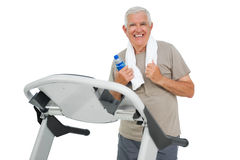 Happy senior man running on a treadmill Royalty Free Stock Photography