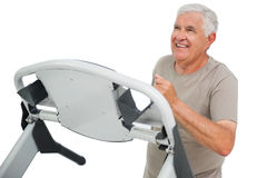 Happy senior man running on a treadmill Stock Photography