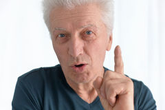 Happy senior man in shirt gestures. Portrait of happy senior man in shirt gestures Royalty Free Stock Image