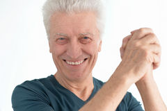 Happy senior man in shirt gestures. Portrait of happy senior man in shirt gestures Stock Photos