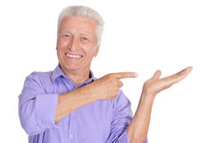 Happy senior man in shirt gestures. Happy senior man in shirt  gestures on white background Stock Photography