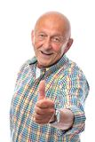 Happy senior man shows thumbs up. Isolated on white royalty free stock photography