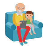Happy senior man sitting on the sofa read with tablet for his grandson. Royalty Free Stock Photo